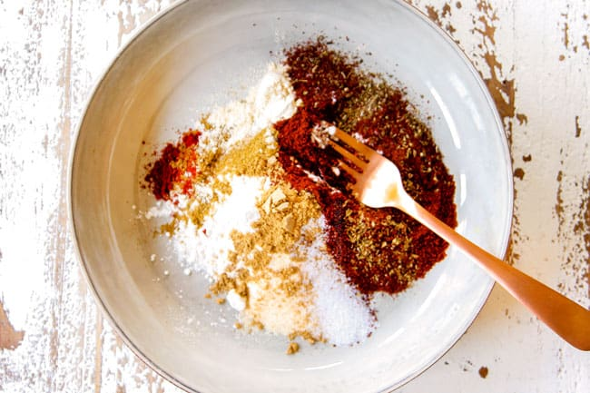 showing how to make enchilada sauce by combining flour, chili powder, dried oregano, cumin, garlic powder, onion powder and smoked paprika