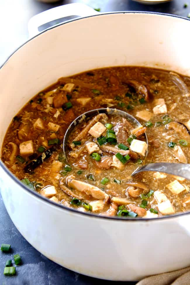 a ladle of easy Hot and Sour Soup recipe scooping up soup