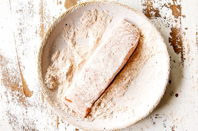 showing how to make lemon salmon and asparagus by dredging salmon in flour