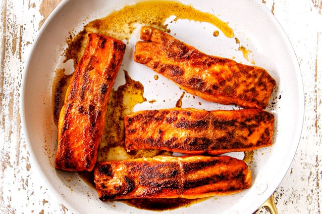 showing how to make lemon salmon and asparagus by cooking salmon in butter