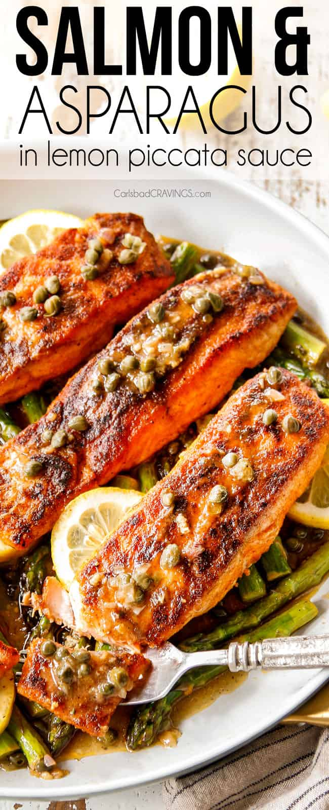 showing how tender lemon salmon and asparagus is taking a bite with a fork