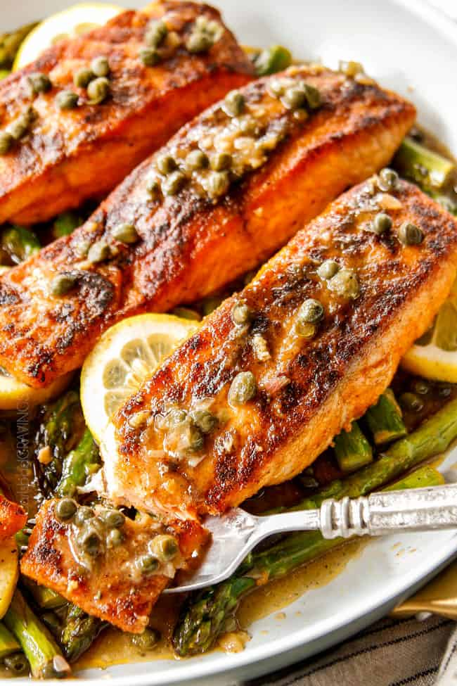up close of showing how tender salmon recipe is by taking a bite