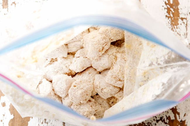 showing how to make sweet and sour chicken by breading chicken in flour and cornstarch