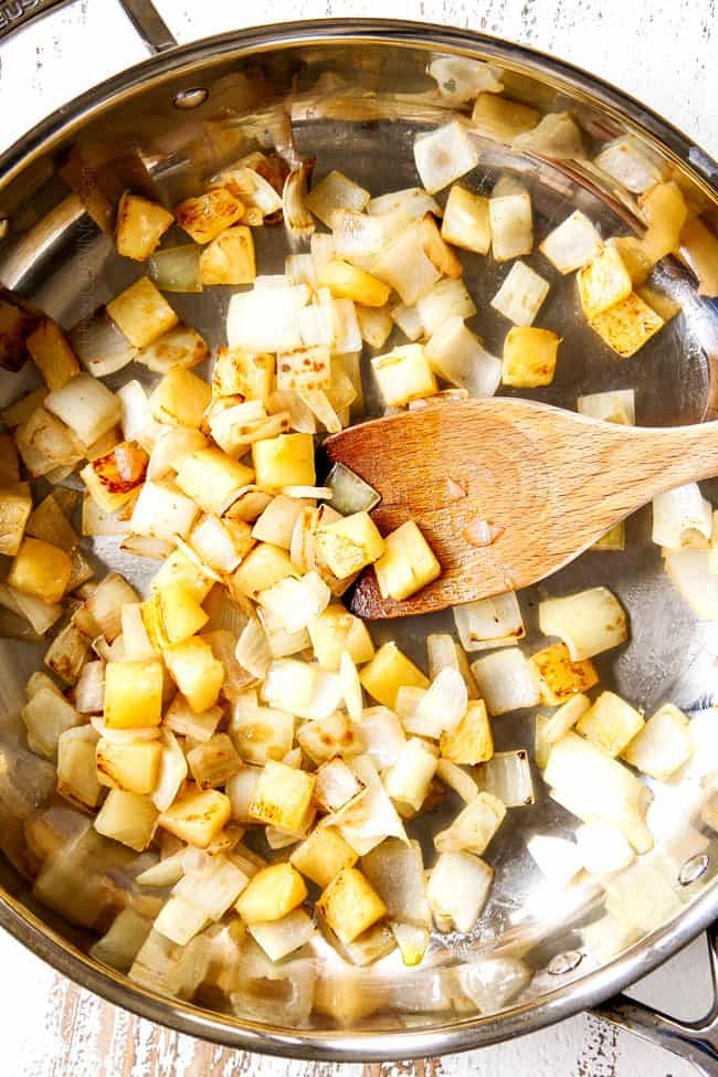 showing how to make sweet and sour chicken by stir frying pineapple and onions