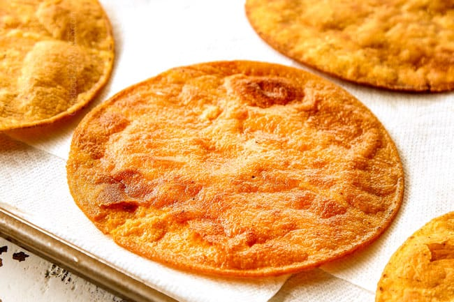 showing how to make tostadas by frying corn tortillas to make tostada shells
