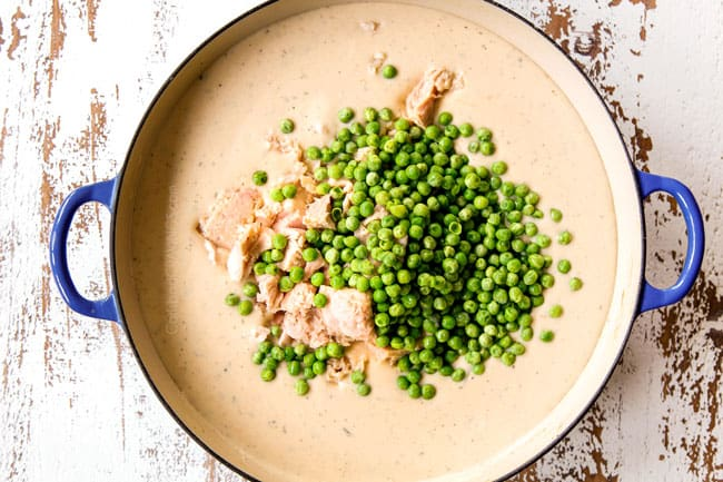 showing how to make Tuna Noodle Casserole by adding tuna and peas to the Mornay sauce