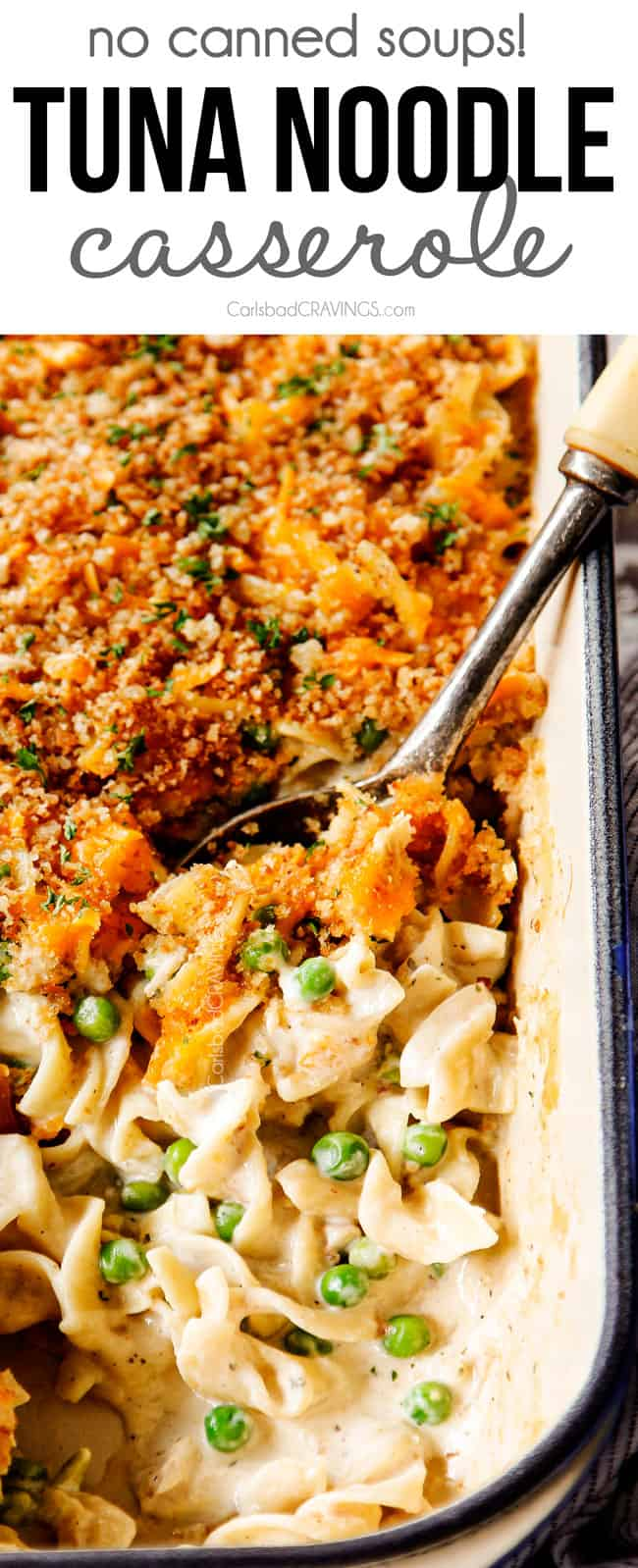 up close of a spoon scooping tuna noodle casserole to show how creamy it is