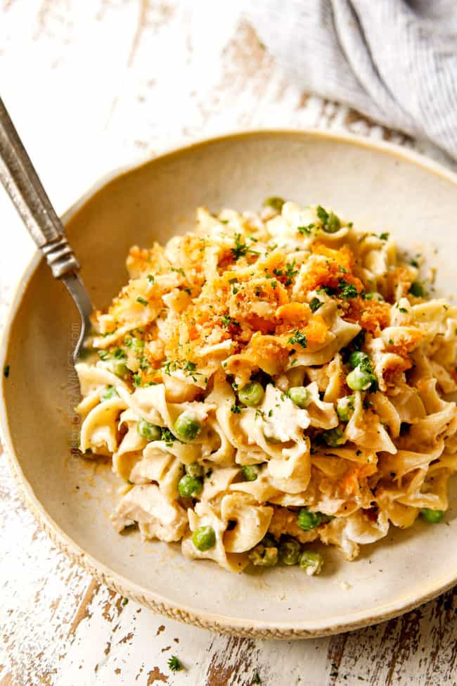 Tuna Noodle Casserole on a serving plate garnished by parsley to show how creamy it is