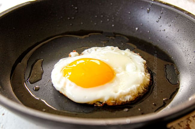 showing how to make Chilaquiles with Fried Eggs by frying eggs in a nonstick skillet