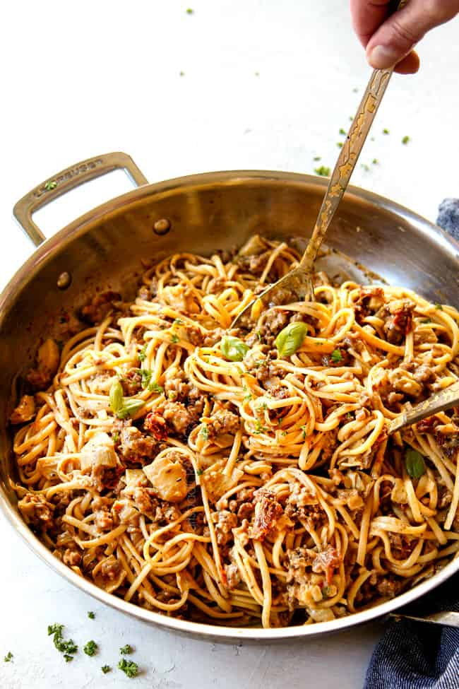 showing how to make linguine pasta by tossing noodles in sauce in a skillet until coated