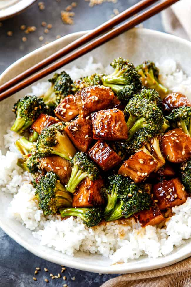 showing how to serve Chicken and Broccoli recipe by adding to a bowl of rice