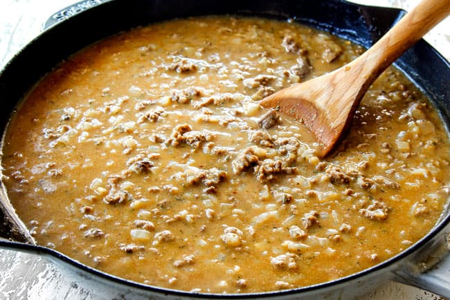 showing how to make best ground beef stroganoff by adding beef broth and seasonings and simmering until thickened