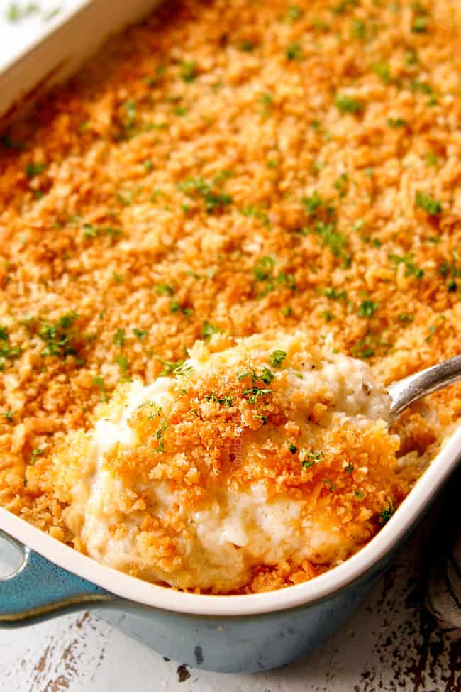 showing how to garnish easy hashbrown casserole by topping with parsley
