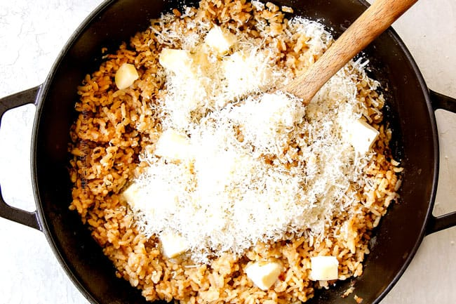 showing how to make mushroom risotto recipe by stirring Parmesan and butter