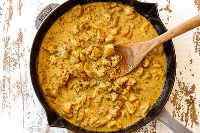 showing how to make peanut butter chicken by simmering until thickened