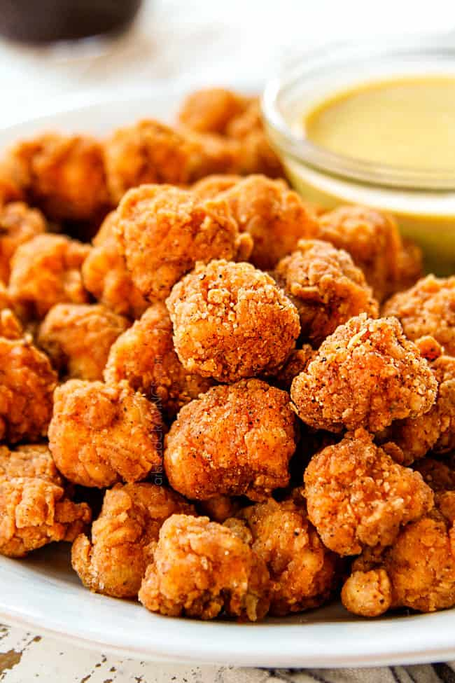 showing how to serve KFC Popcorn Chicken by serving with Honey Mustard Dip