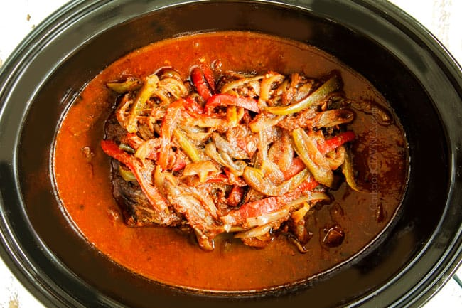 showing how to make crockpot Ropa Vieja recipe by cooking beef until tender in the crockpot