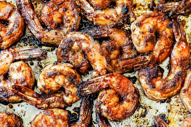 showing how to make jerk shrimp cooking in a skillet