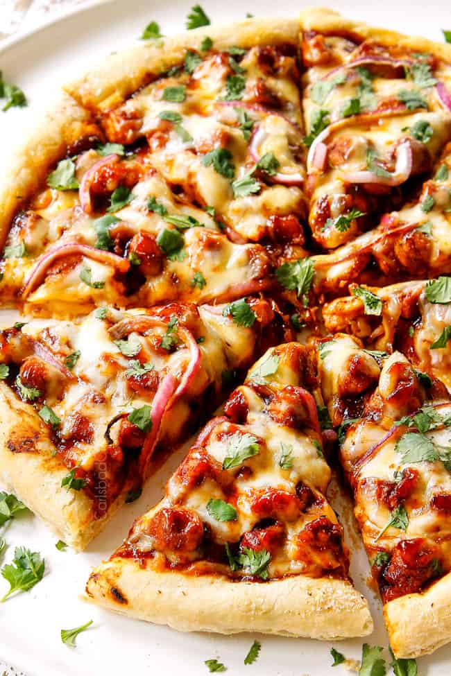 showing how to make BBQ Chicken Pizza by slicing pizza after it's baked