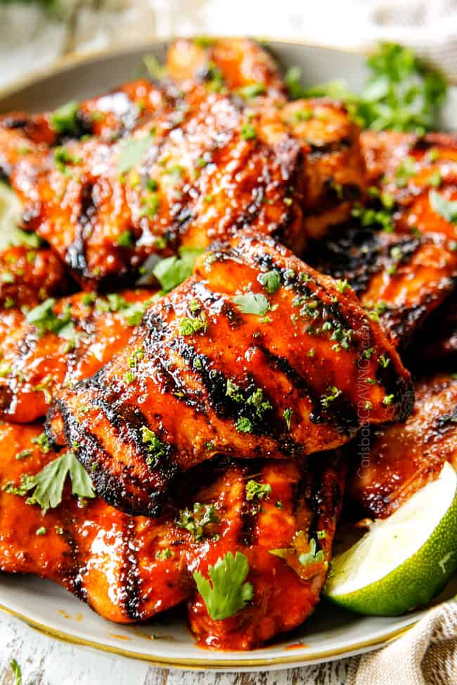 up close of Honey Sriracha Chicken recipe with grill marks garnished with cilantro