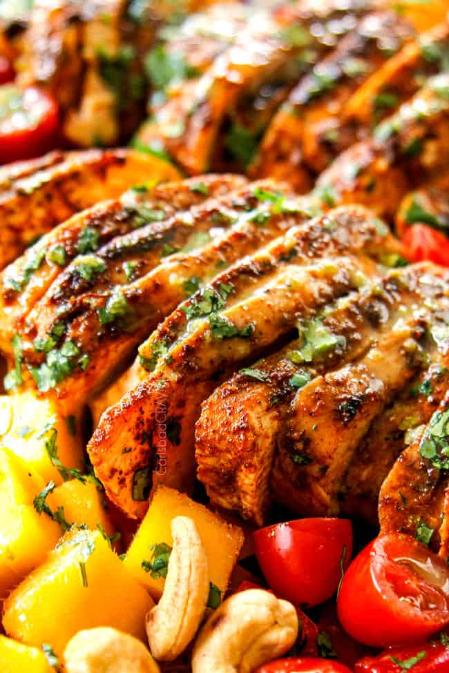 showing up close of chicken in mango salad showing how juicy chicken is