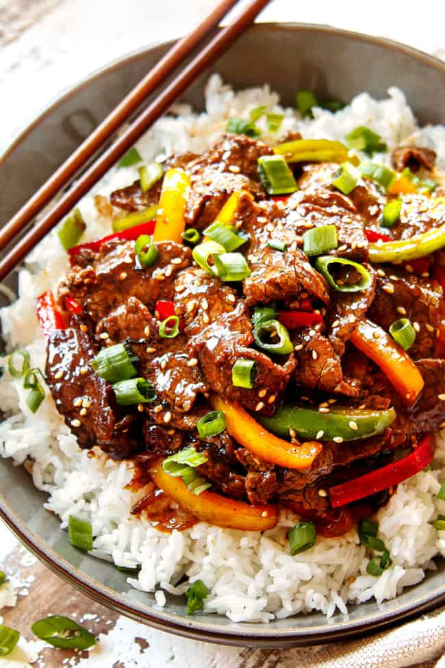 pepper steak in a bowls served with rice