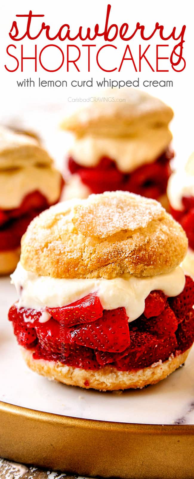 showing how layer strawberry shortcake recipe by layering biscuits with strawberries, whipped cream and a golden biscuit