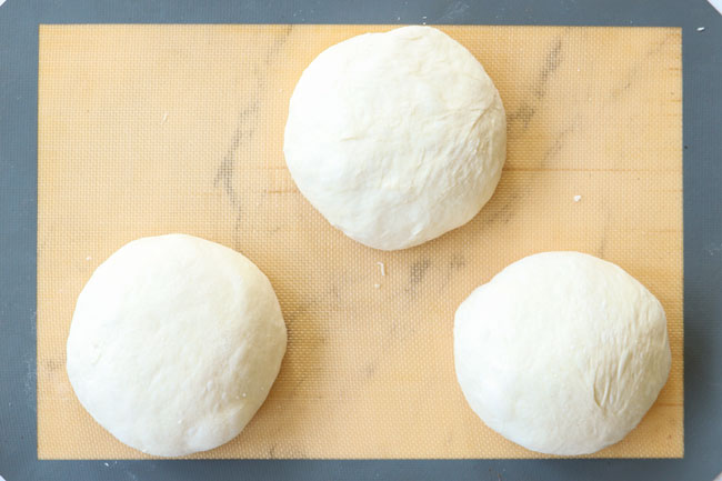 showing how to make homemade pizza dough by dividing into three balls