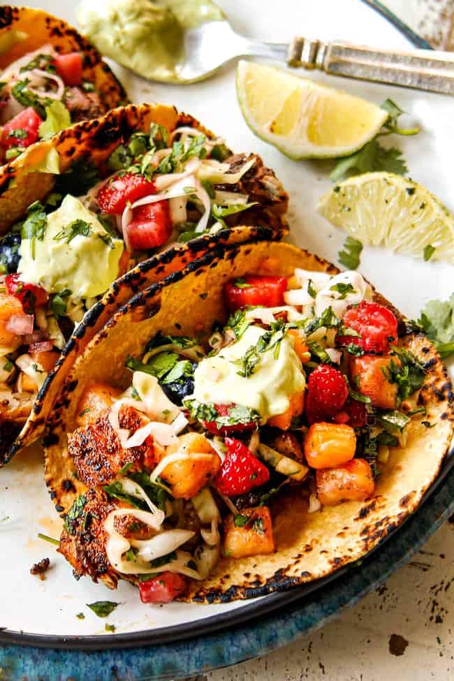 up close of mahi mahi fish taco on a white plate