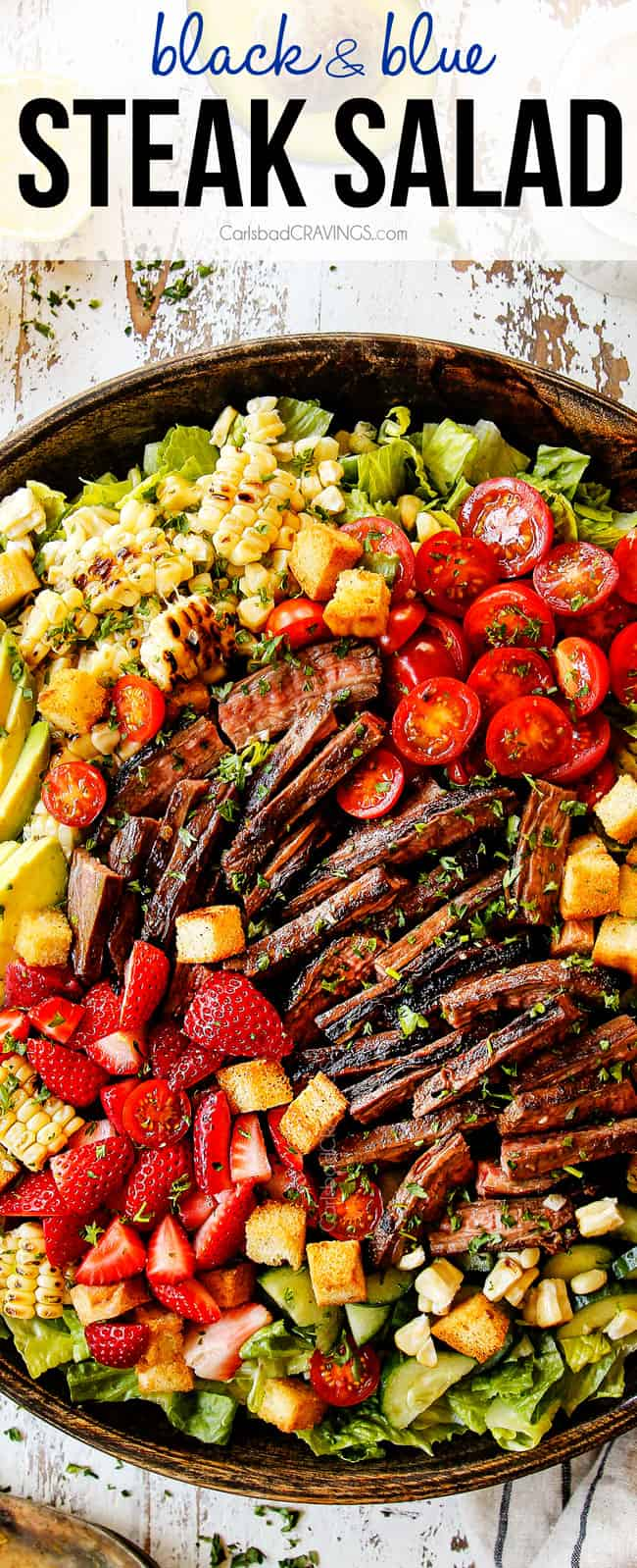 top view of grilled steak salad with grilled corn,tomatoes and avocado in a wooden bowl