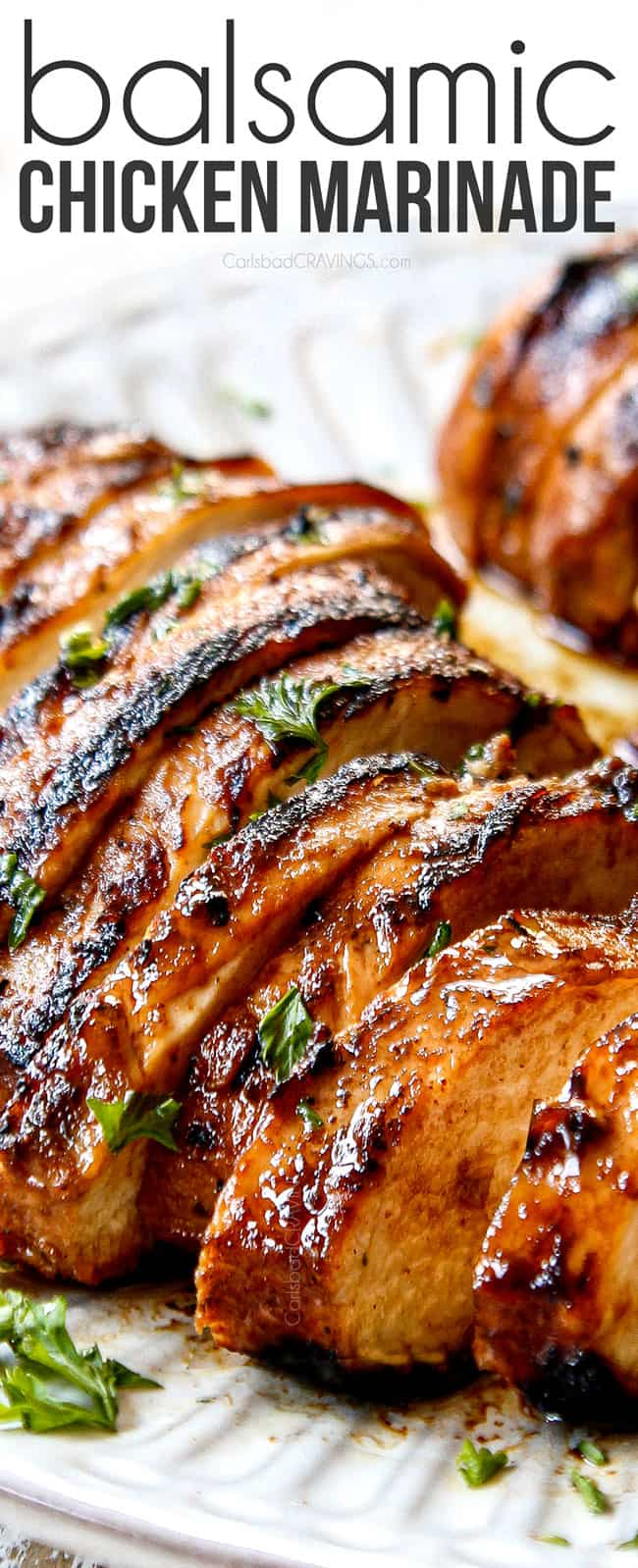 up close of marinated balsamic chicken thinly sliced on a plate showing how juicy it is