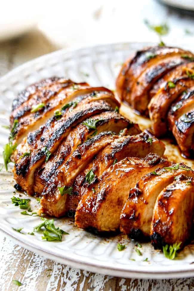 side view of marinated balsamic chicken sliced on a plate