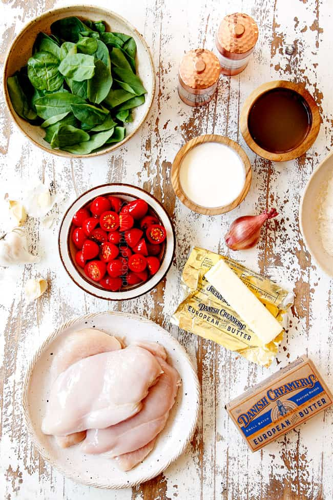 showing how to make Chicken Florentine recipe with a top view of the ingredients in bowls: spinach, tomatoes, chicken, heavy cream, butter