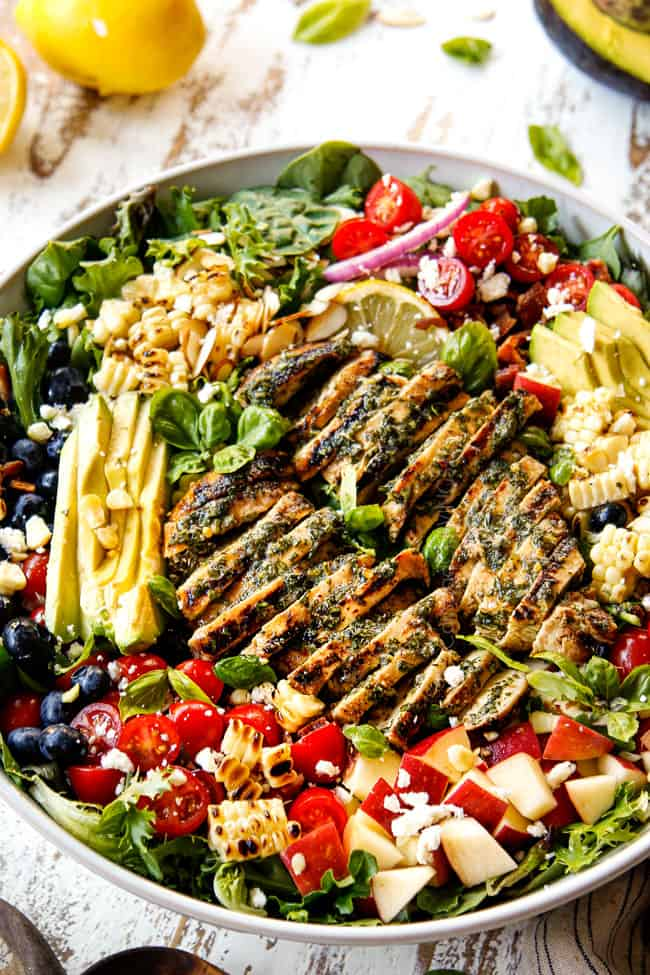grilled chicken salad recipe in a white bowl with basil vinaigrette