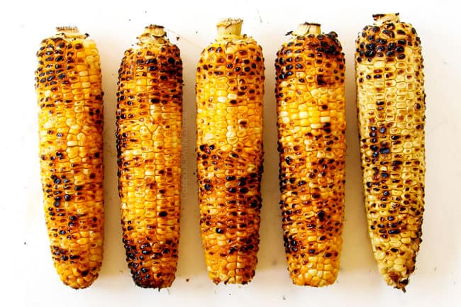 showing how to make esquites (Mexican Street Corn Salad) by grilling 5 pieces of corn on the cob