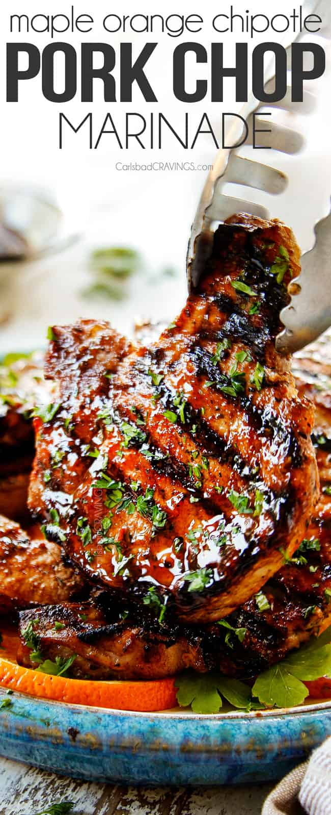 tongs holding up a grilled marinated pork chop