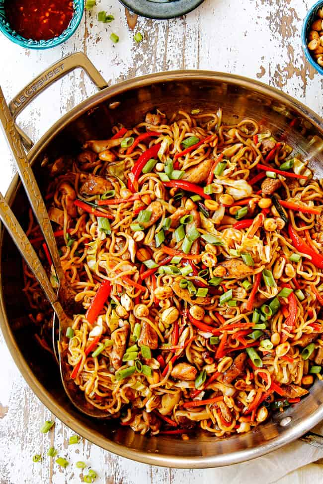 showing how to make chicken yakisoba by tossing chicken and sauce with yakisoba noodles