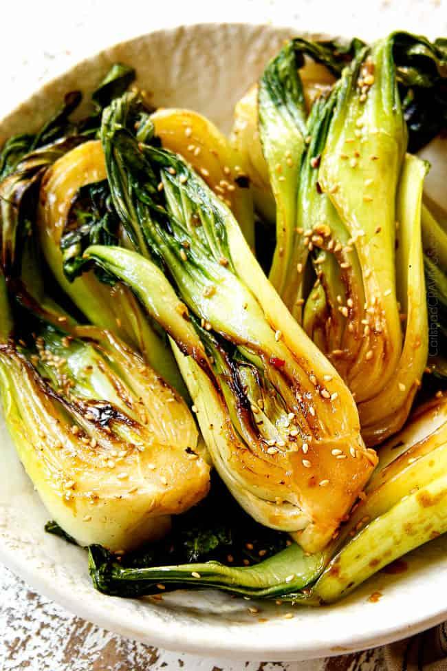 bok choy recipe in a white bowl glazed with sesame soy glaze