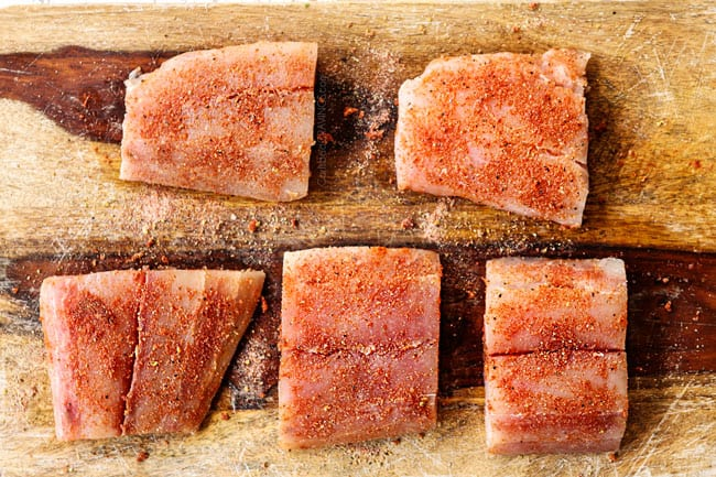 showing how to cook mahi mahi by seasoning with paprika, onion powder, garlic powder, salt and pepper on a cutting board