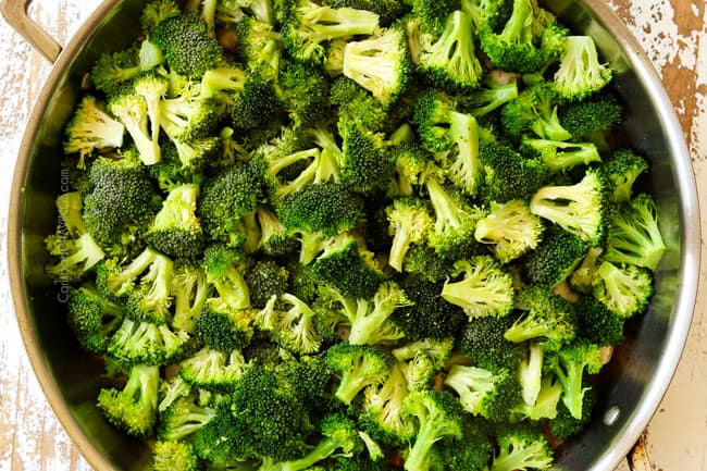 showing how to make chicken broccoli and rice casserole by adding broccoli to a skillet and steaming until tender