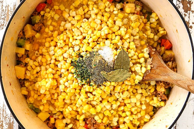 top view showing how to make corn chowder by adding corn, creamed corn, chicken broth, parsley, thyme and oregano
