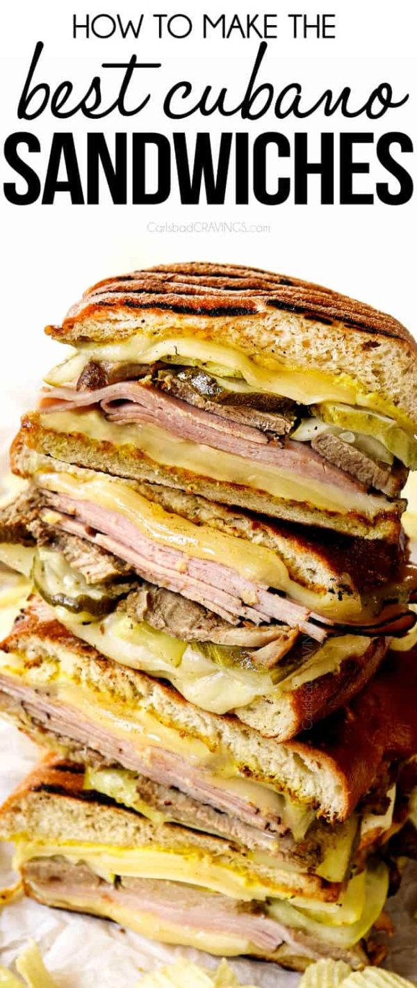 Cuban sandwiches (Cubanos) stacked on top of each other showing the layers of Swiss cheese, ham, mojo pork