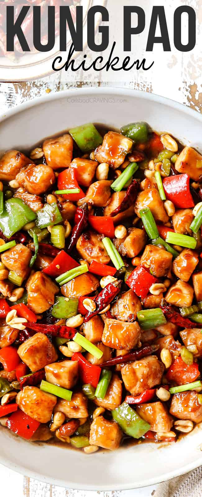 top view of kung pao chicken recipe in a white skillet