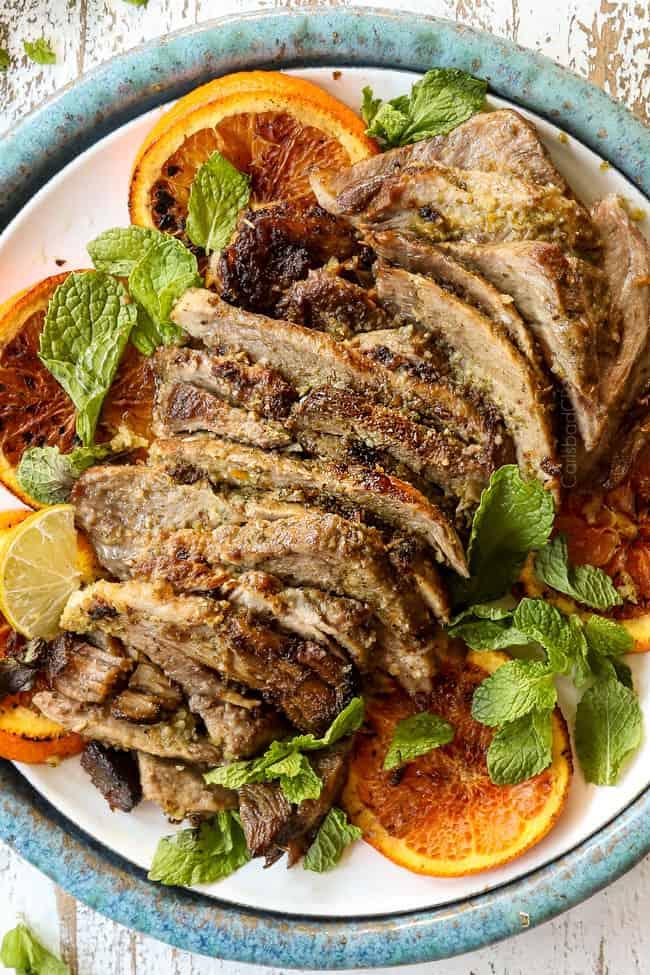 showing how to make mojo Cuban roast pork (lechon asado) by