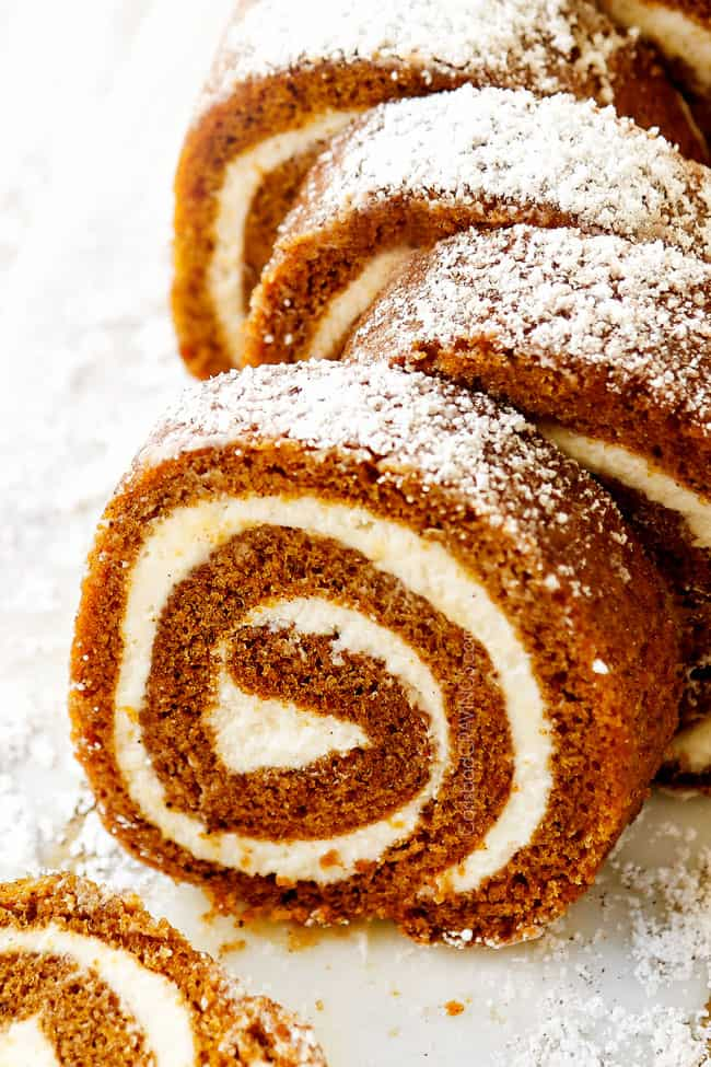 front view of easy pumpkin roll recipe on a white cutting board