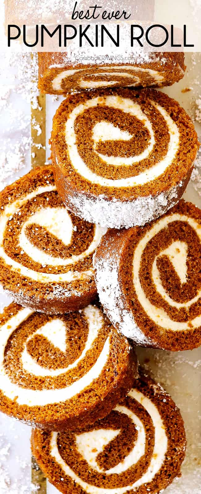 top view of pumpkin roll recipe sliced on a white cutting board