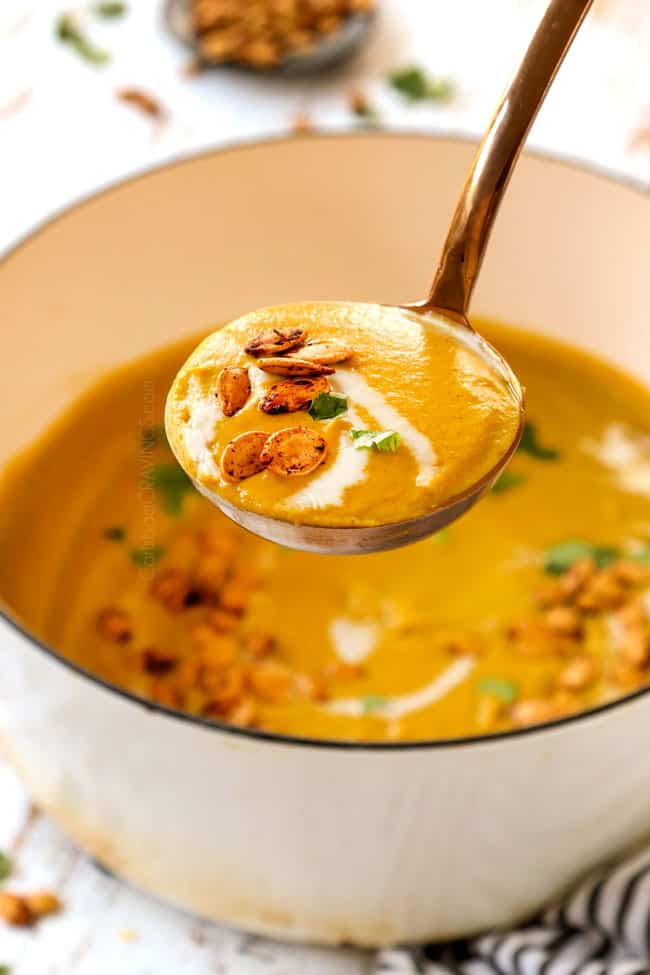 picking up a ladle pumpkin soup recipe showing how creamy it is