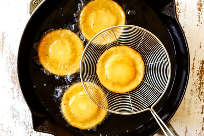 showing how to make sopes by frying sopes in oil
