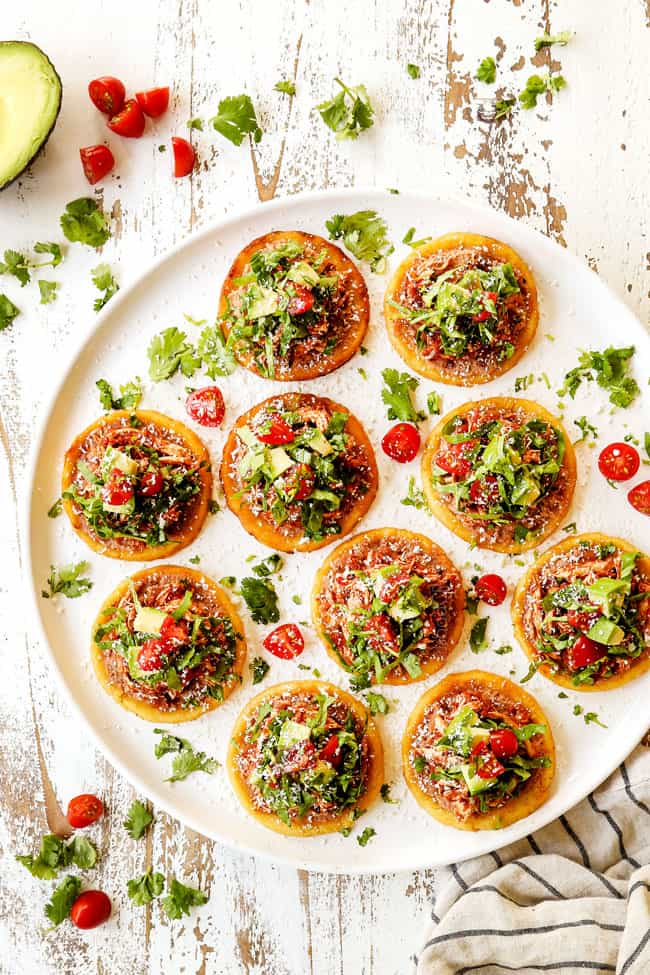 top view of sopes on a white platter