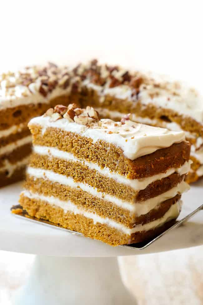 a slice of pumpkin spice cake showing the layers